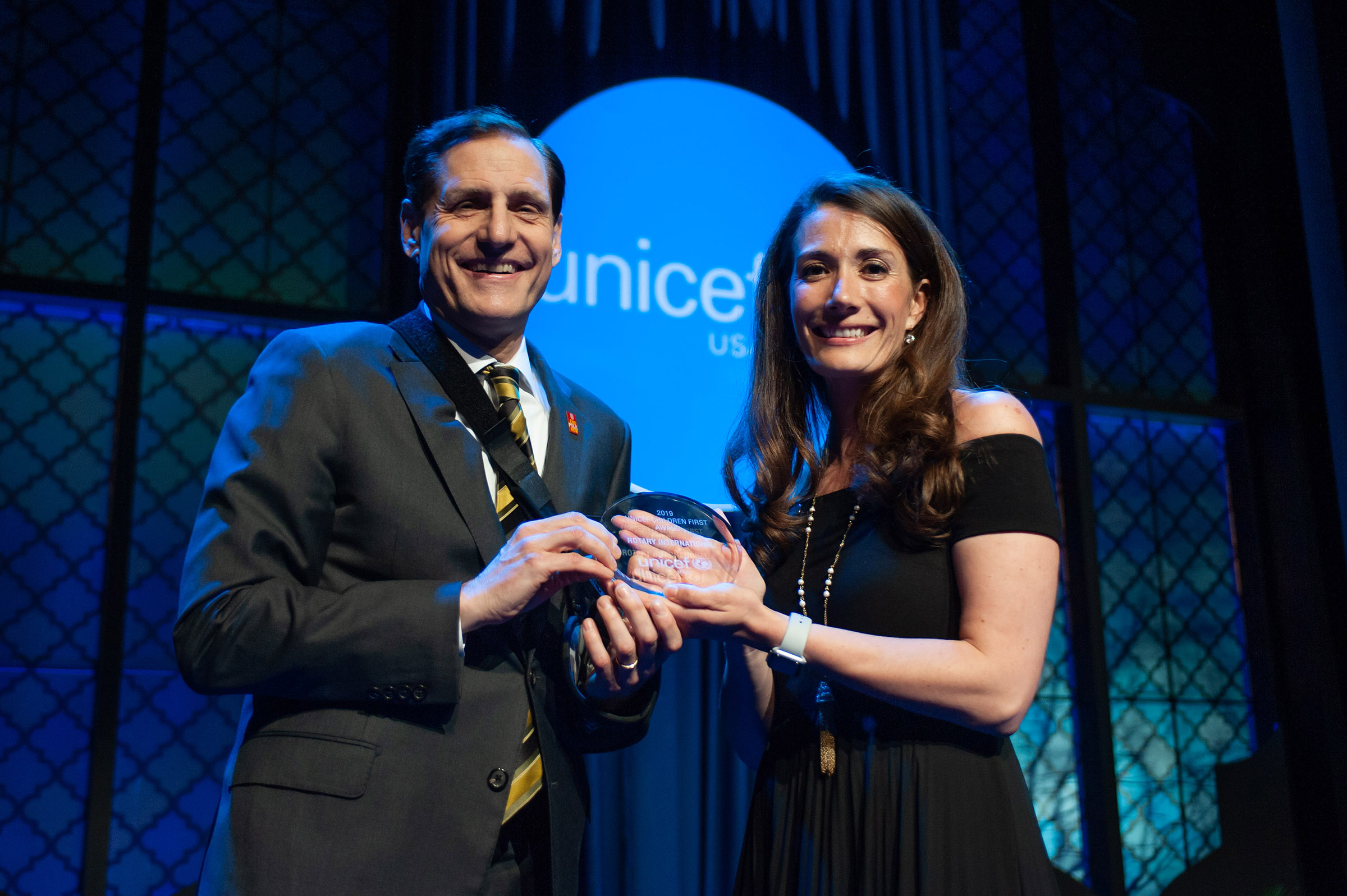 Rotary International General Secretary John Hewko accepts UNICEF's Children First Award.